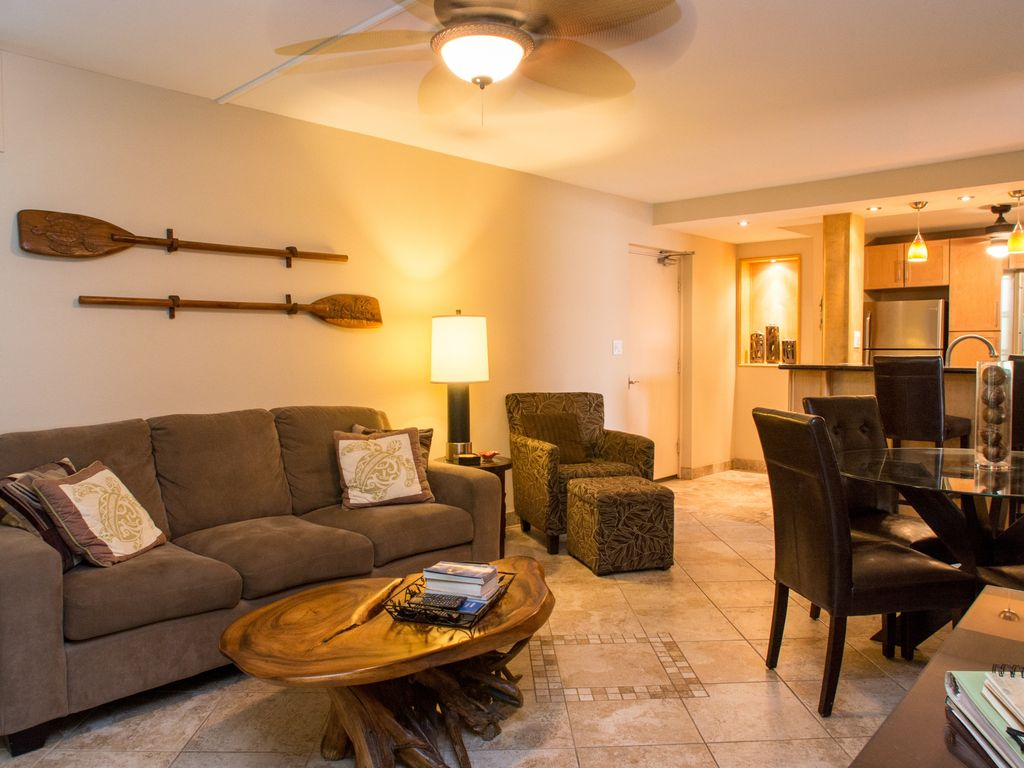 The spacious air conditioned Living Room opens to the Lanai.