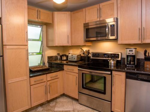 Gorgeous Kitchen with maple cabinets, stainless appliances & granite counters.