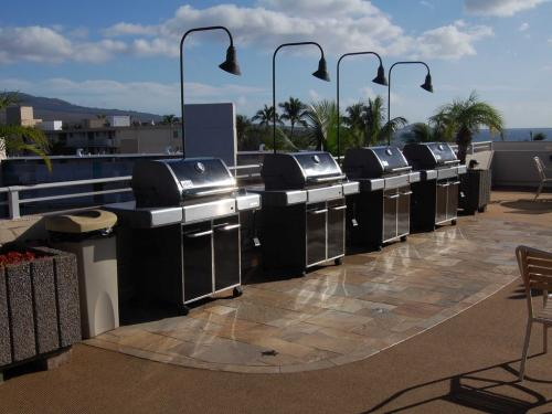 Commercial-grade gas grills are for your use on the Rooftop Deck.